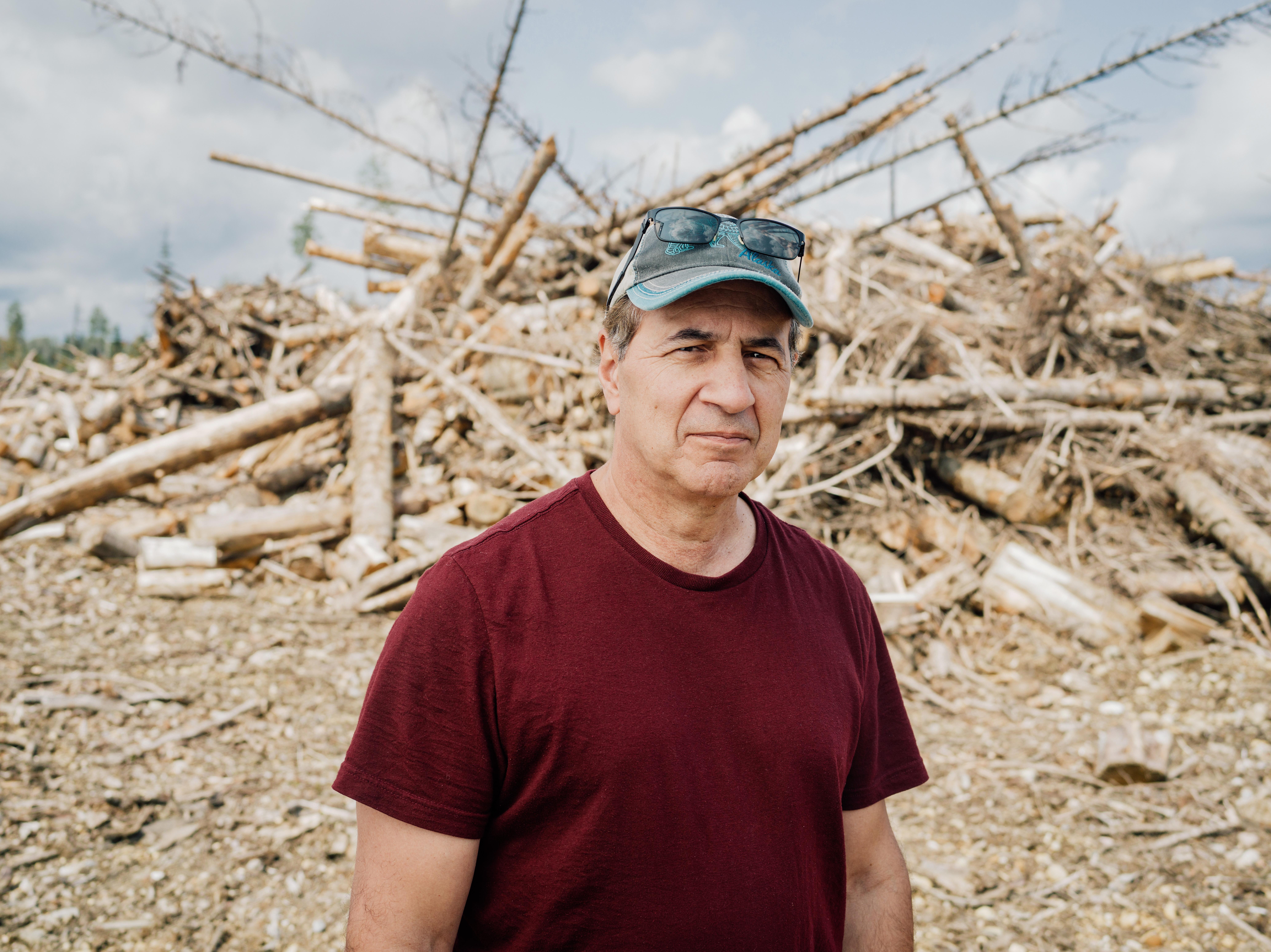 Dr. Dominick DellaSala in front of a slash pile