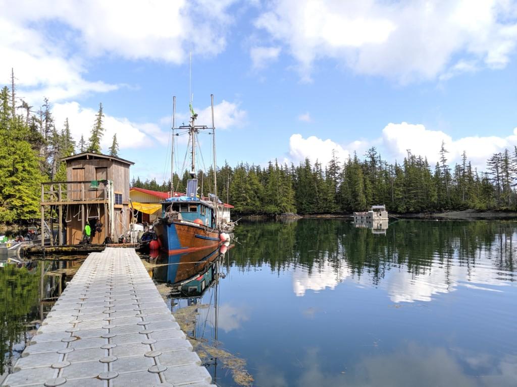 A boat sits on a quiet bay along the Haida Gwaii coastline. Photo: Jason G. Goldman