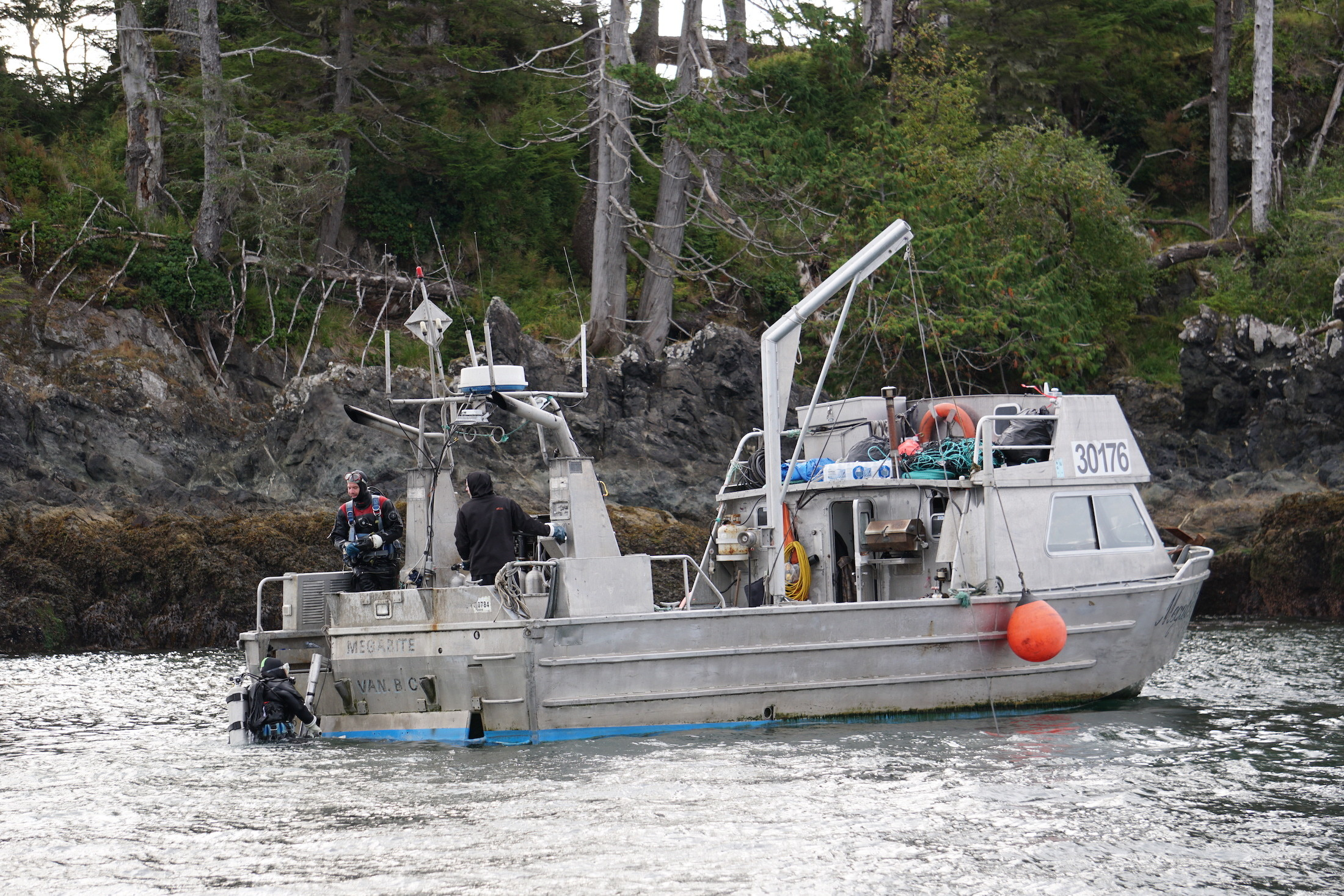 Commercial urchin divers wrap up a day working to restore the kelp forest ecosystem off Haida Gwaii by collecting sea urchins and distributing their roe to local communities. Photo: C. Houston