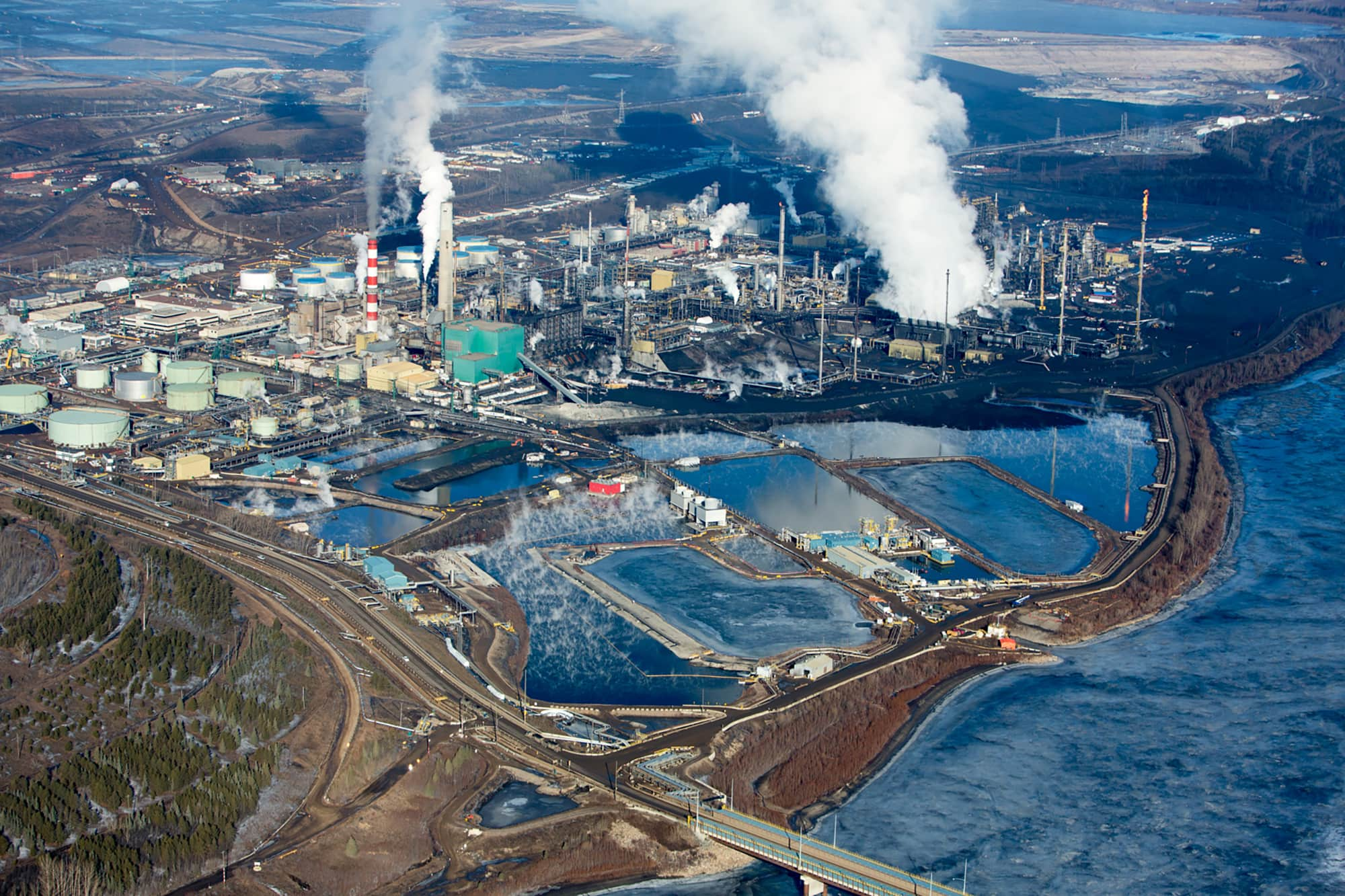 oilsands refinery from above with plumes of smoke