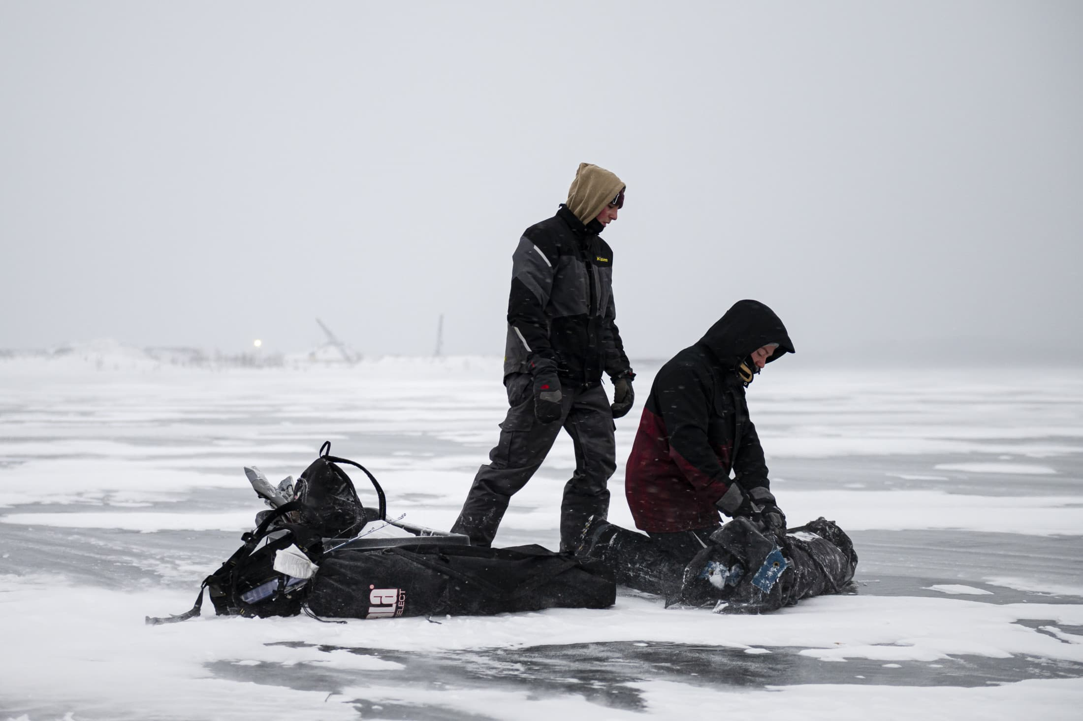 Liam O'Conner and Tristan Charron set up an ice fishing tent