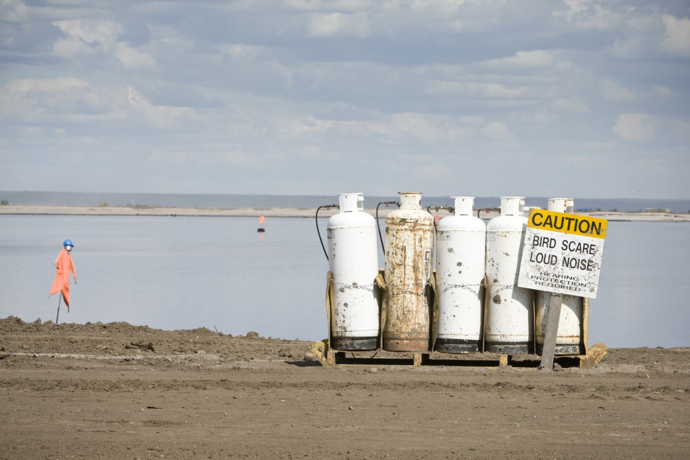 Propane bird scares are used on tailings ponds to prevent birds from landing on the water.