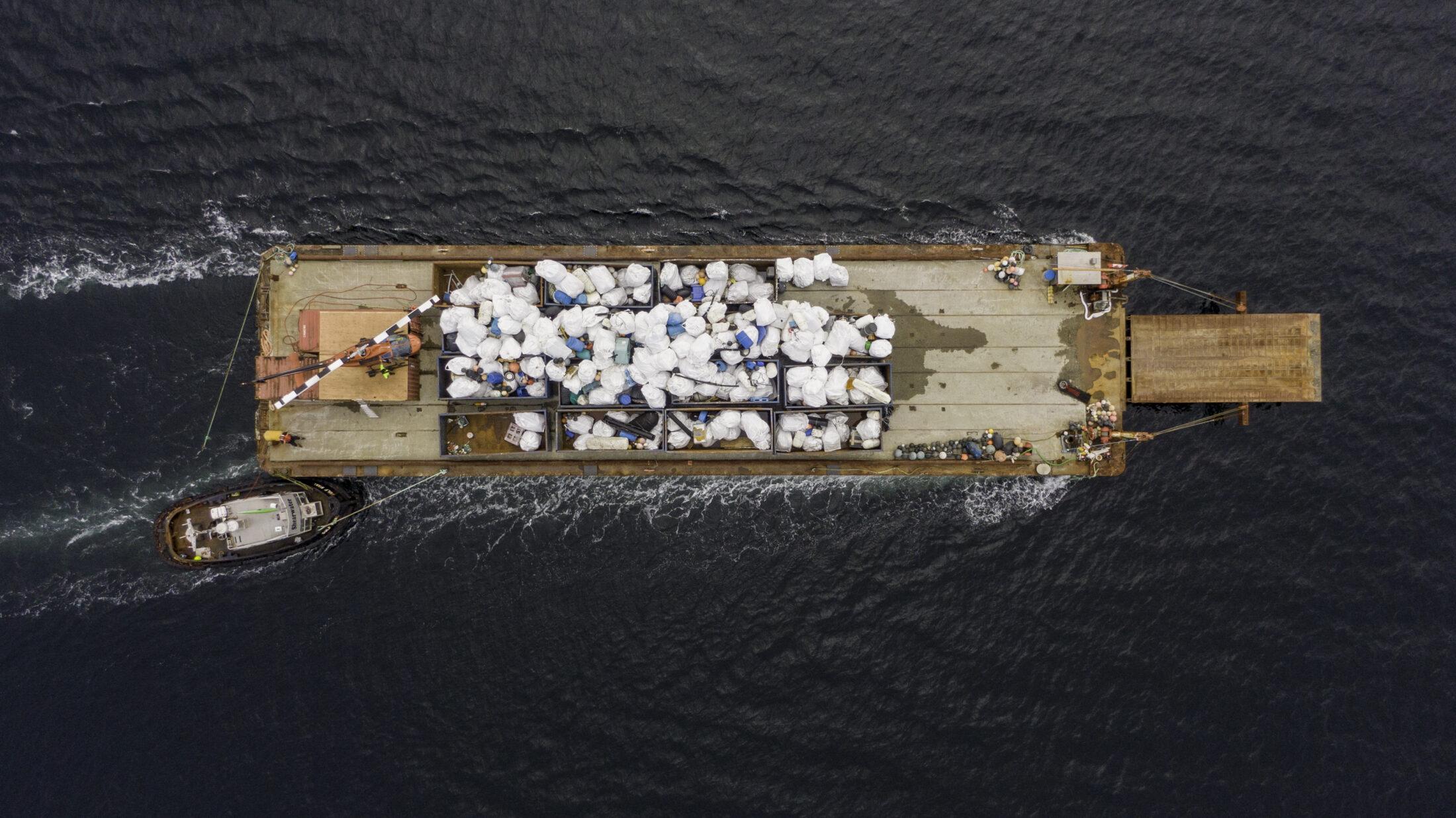Barge moving debris, Clean Coast, Clean Waters Initiative