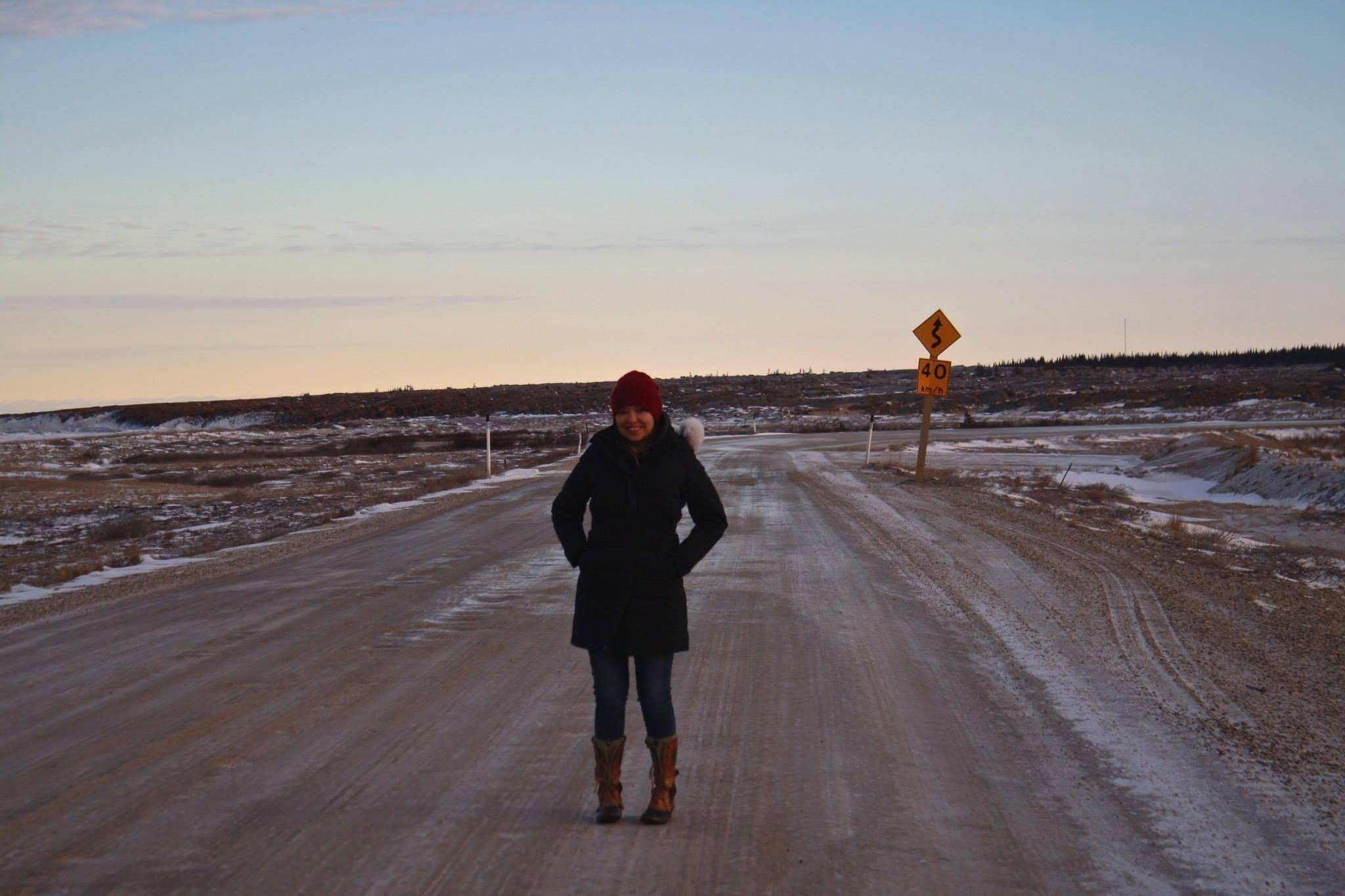 Stephanie Thorassie standing on an empty dirt road in Churchill