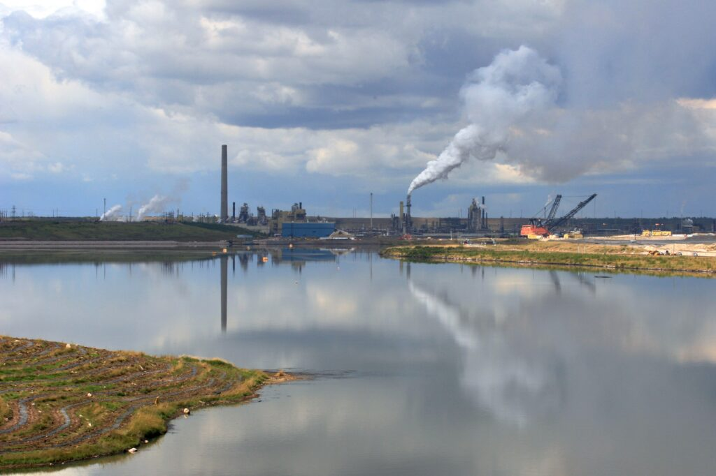 tailings pond in front of industrial setting