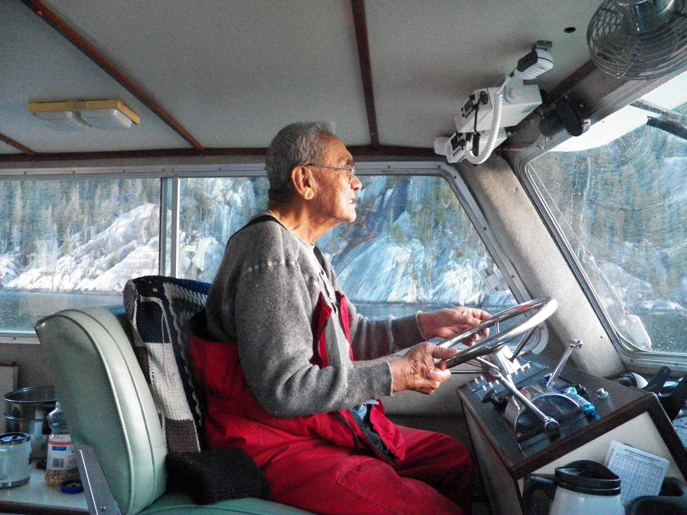 Cecil Paul driving the boat