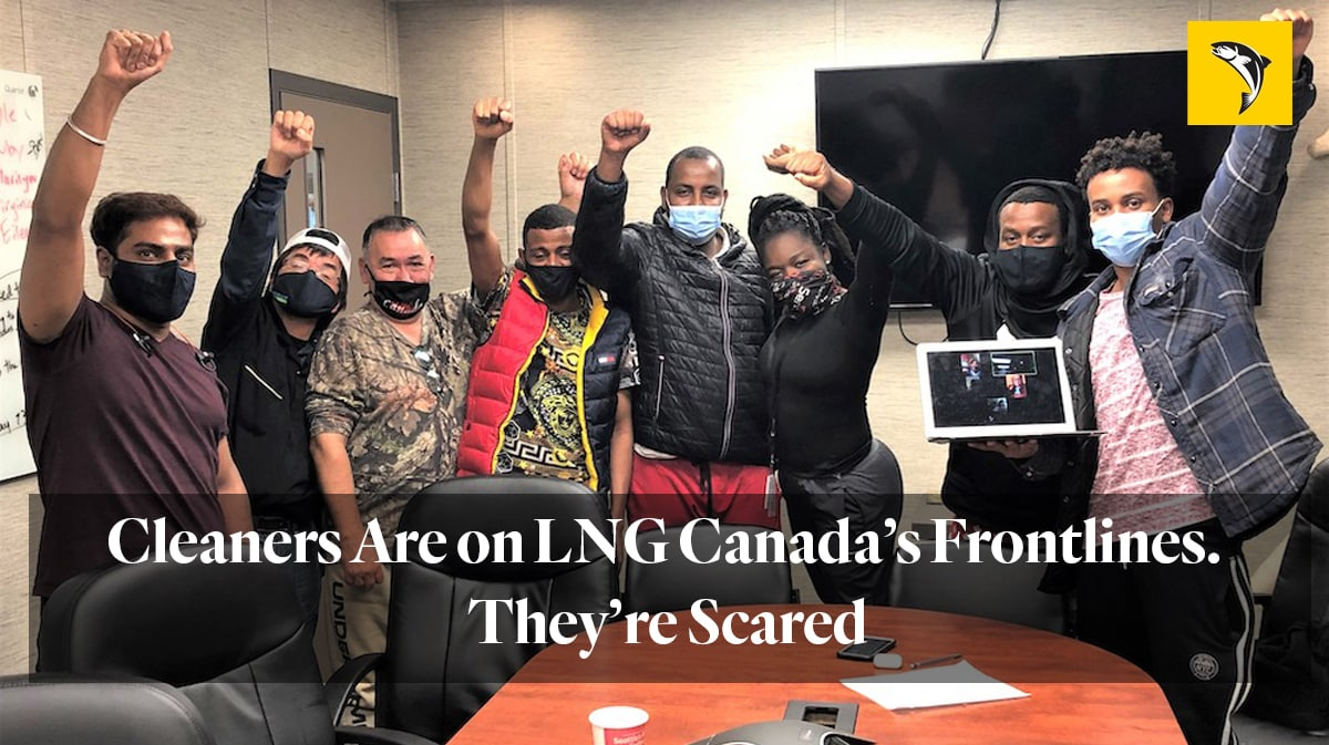 """eight people in a conference room wearing masks and raising their fists """"Cleaners are on LNG Canada's frontlines. they're scared"""" from the tyee"""