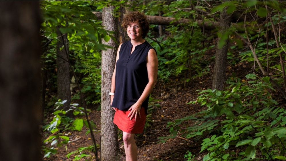 Colleen Cassady St. Clair posing in the woods