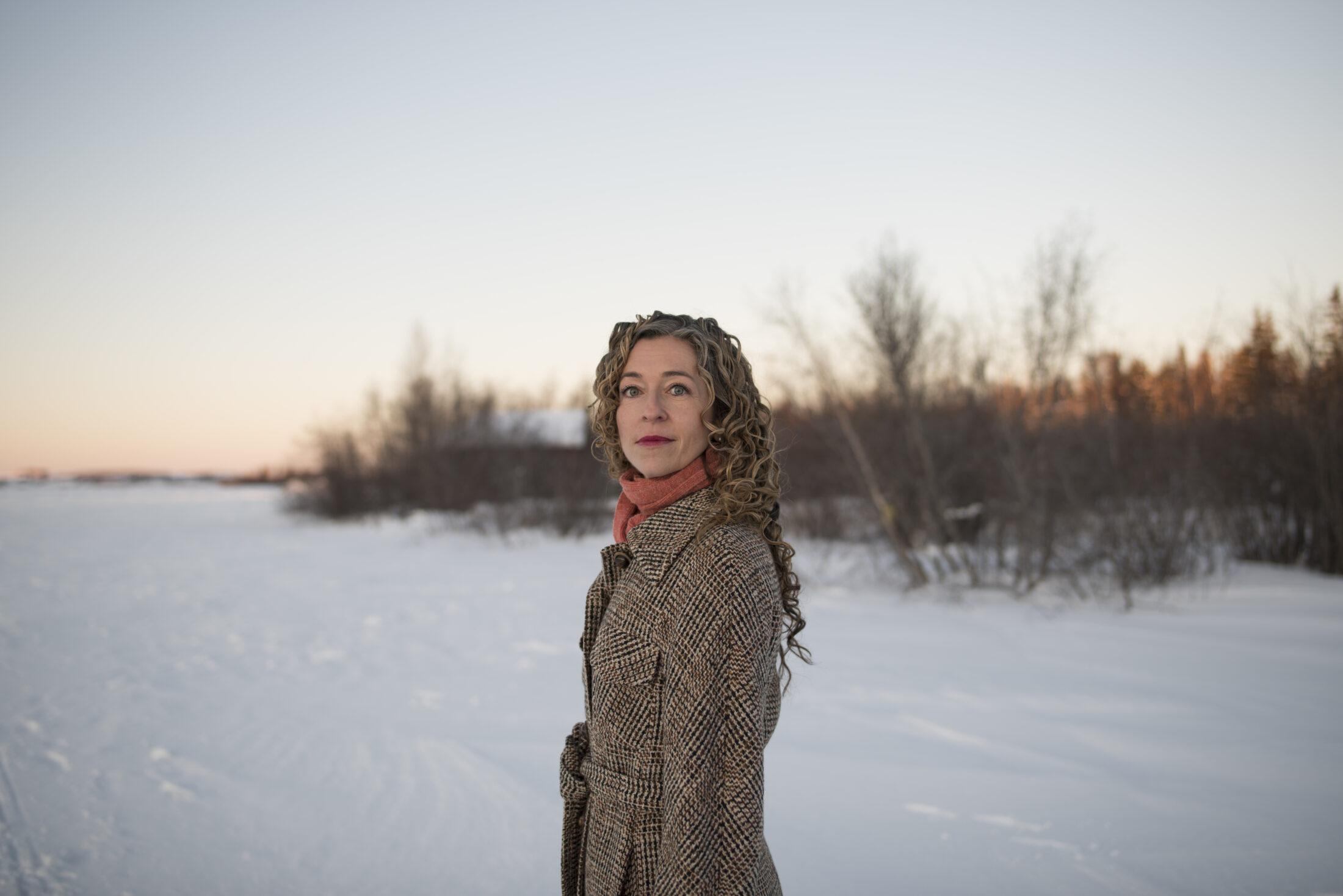 courtney howard standing in a snowy field
