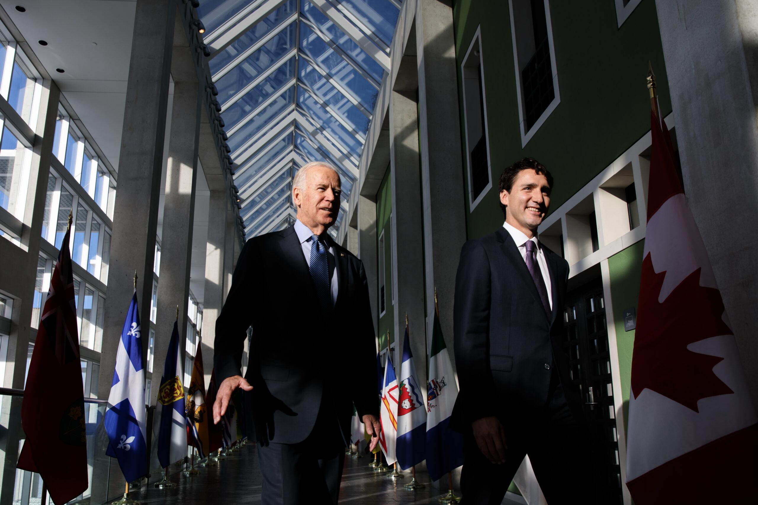 U.S. President Joe Biden and Prime Minister Justin Trudeau walking together indoors