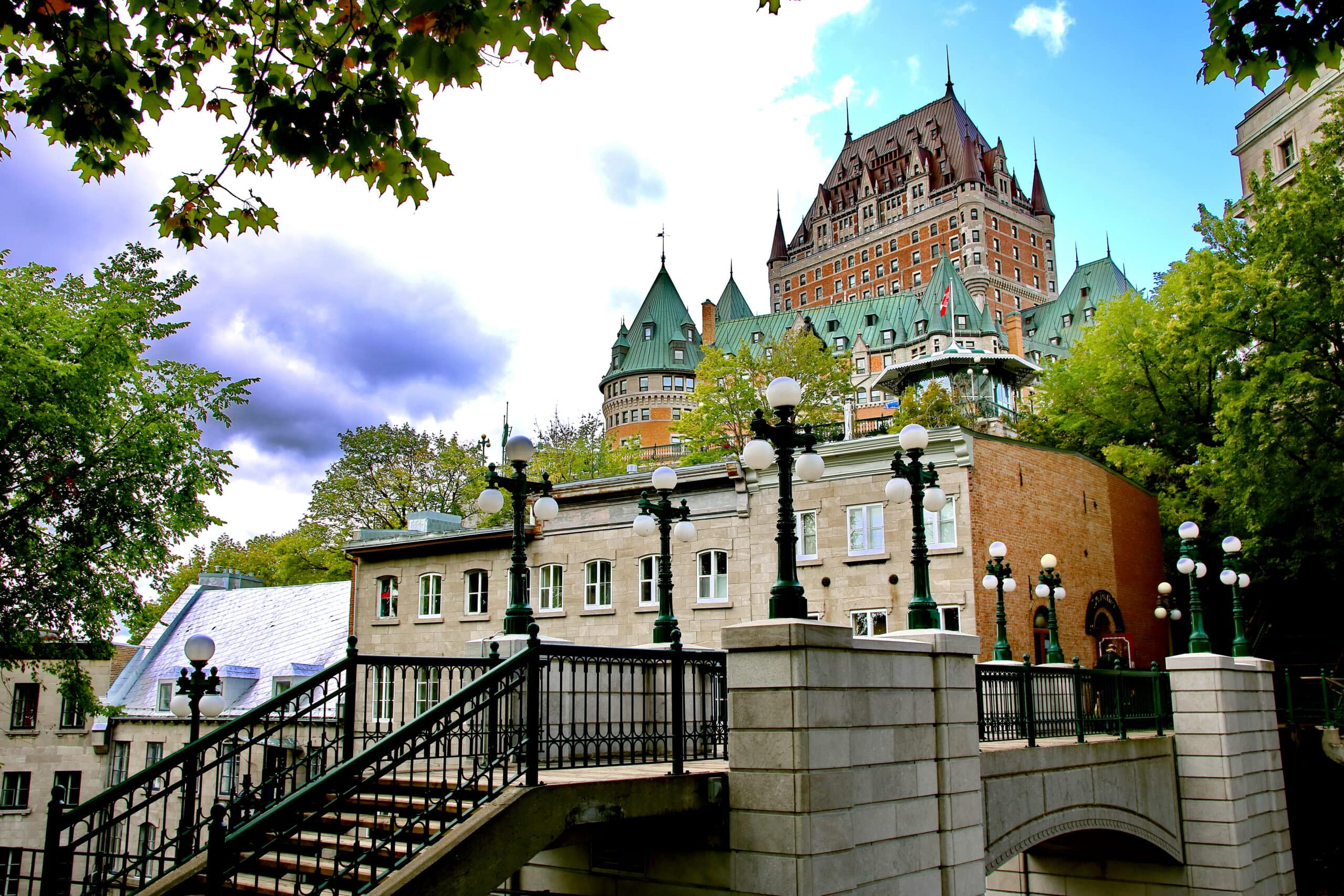 view of quebec city from the ground framed by trees