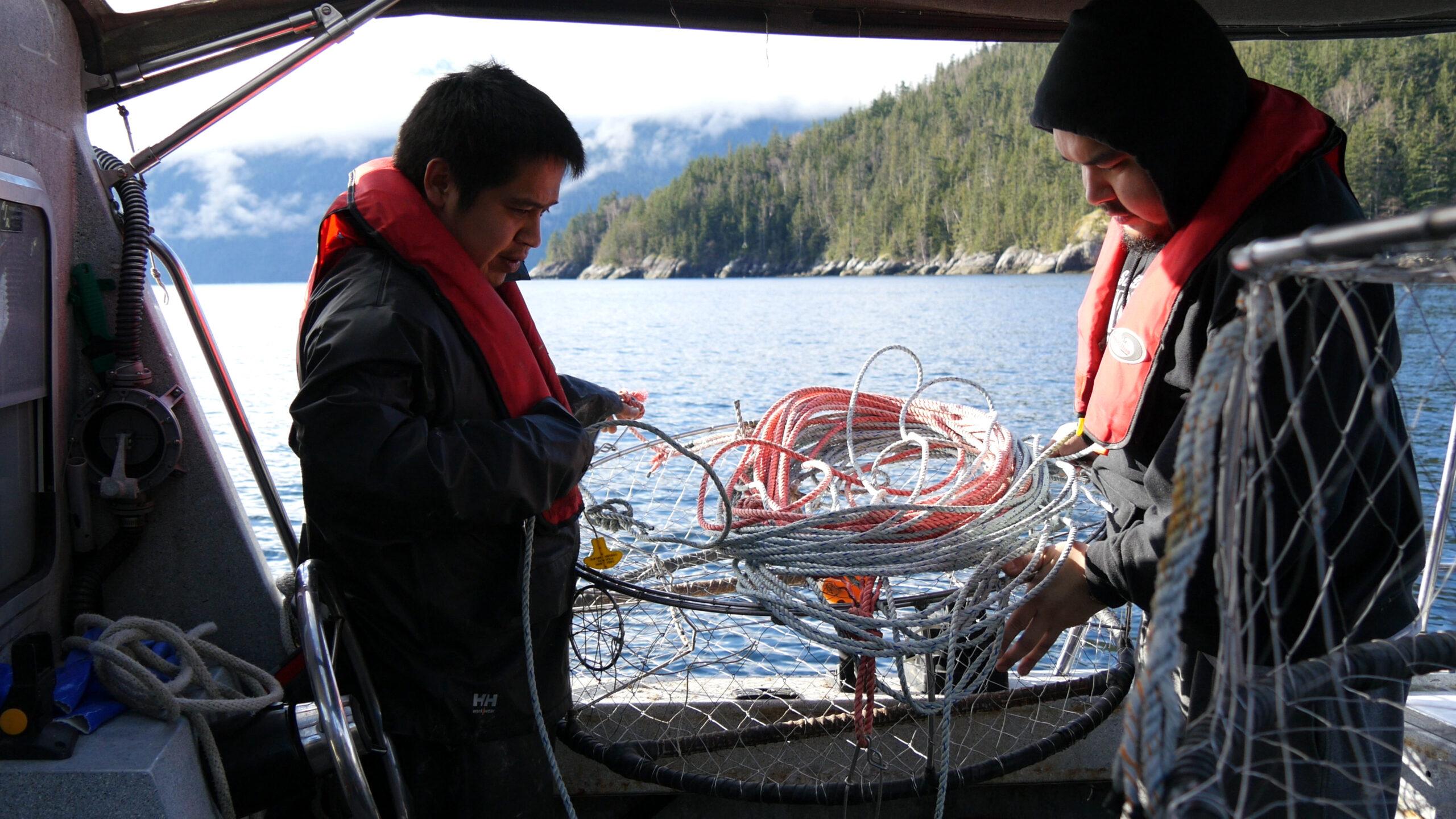 Nuxalk guardian watchmen prepare crab traps