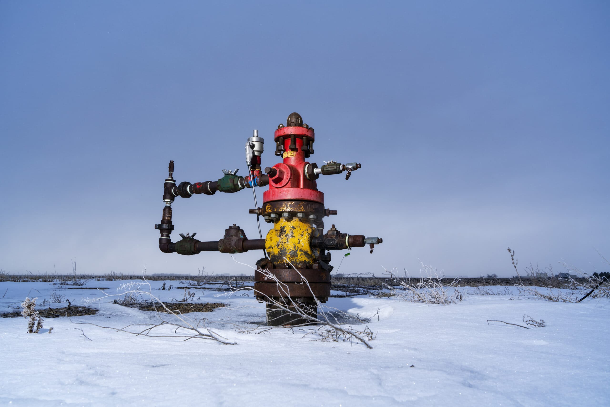 An oil well in the snow near Taber, Alberta