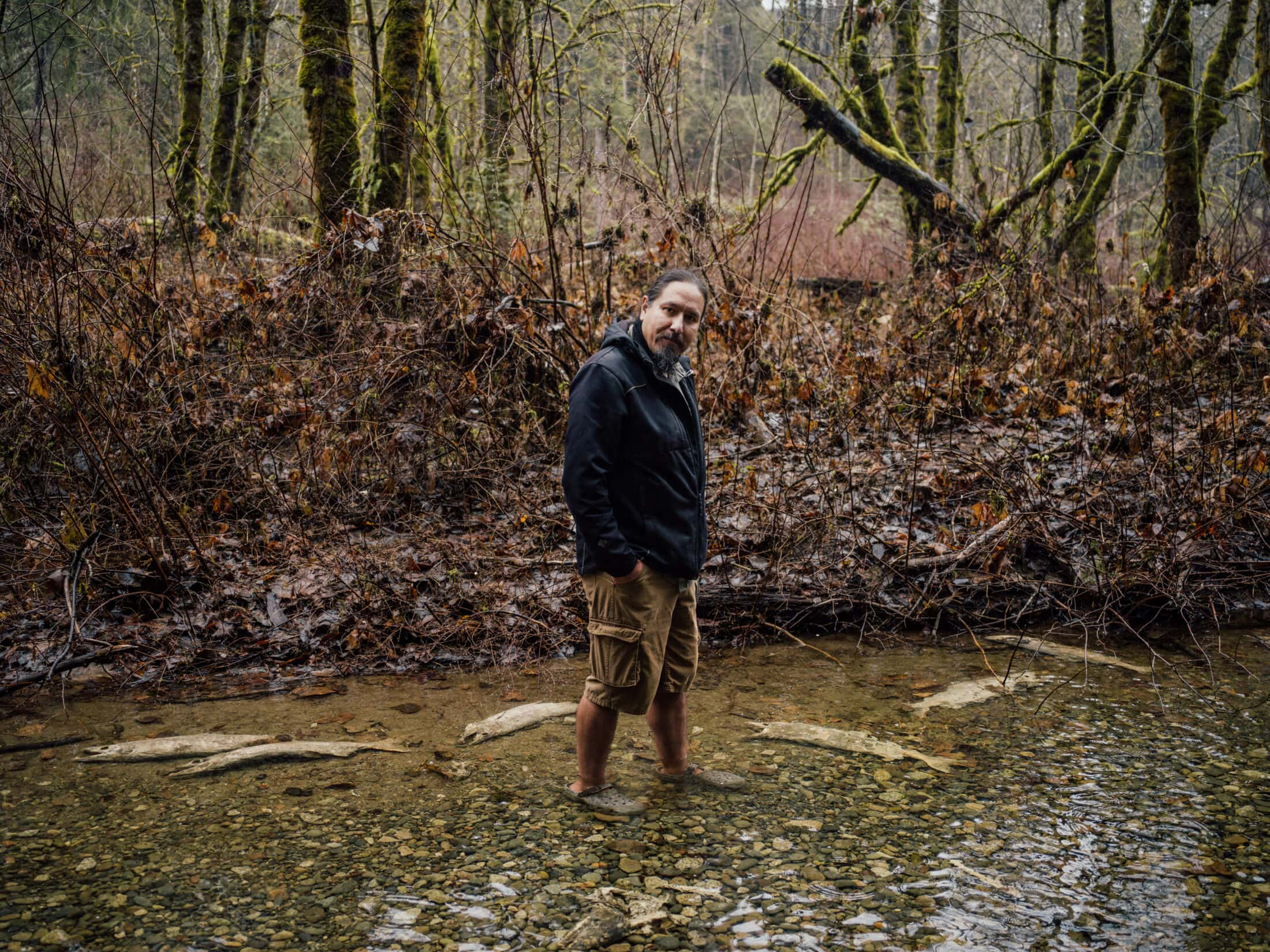 Tim Kulchyski Cowichan Tribes member stands in a river