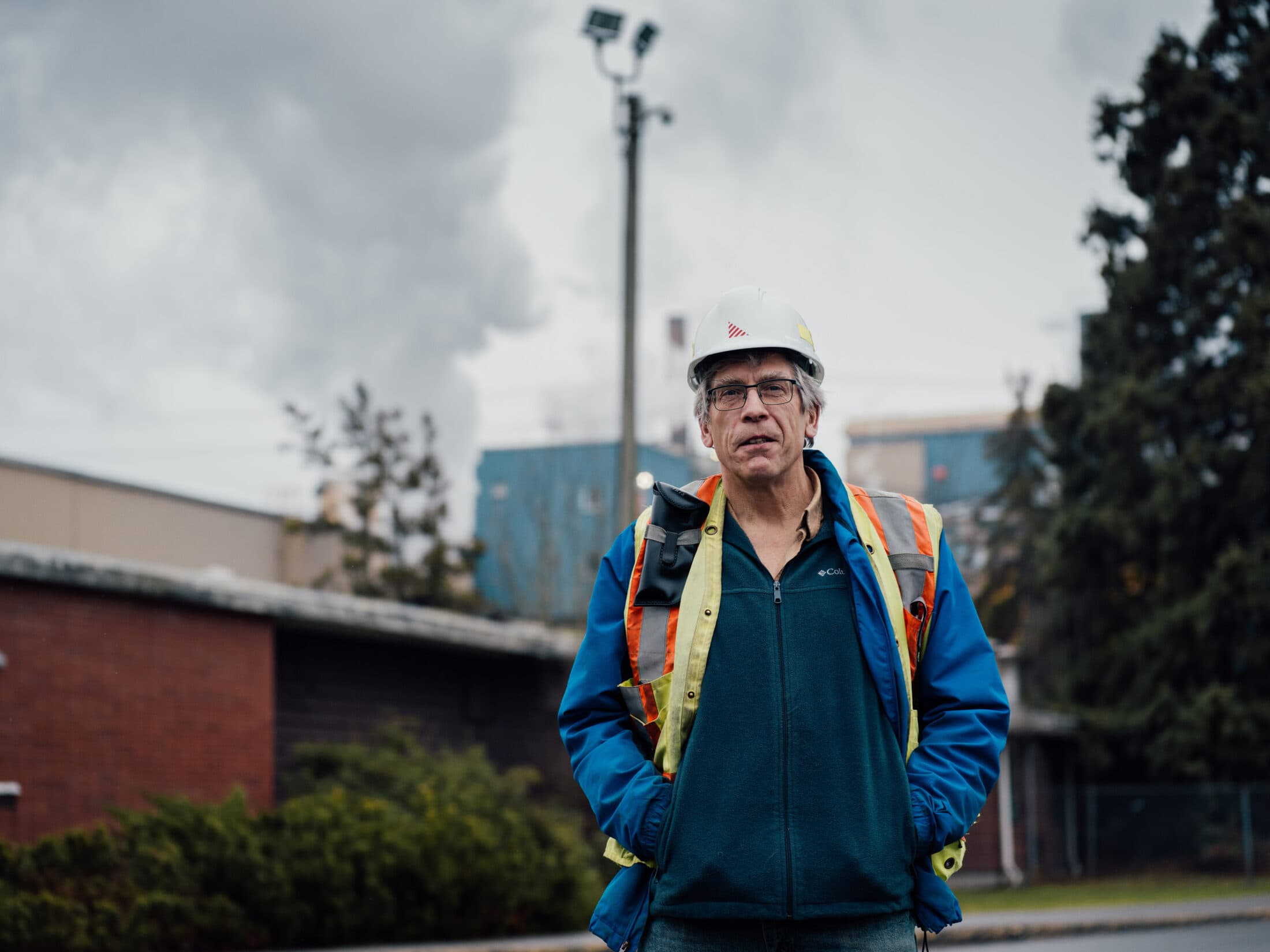Brian Houle stands in front of the Catalylst Pulp and Paper mill