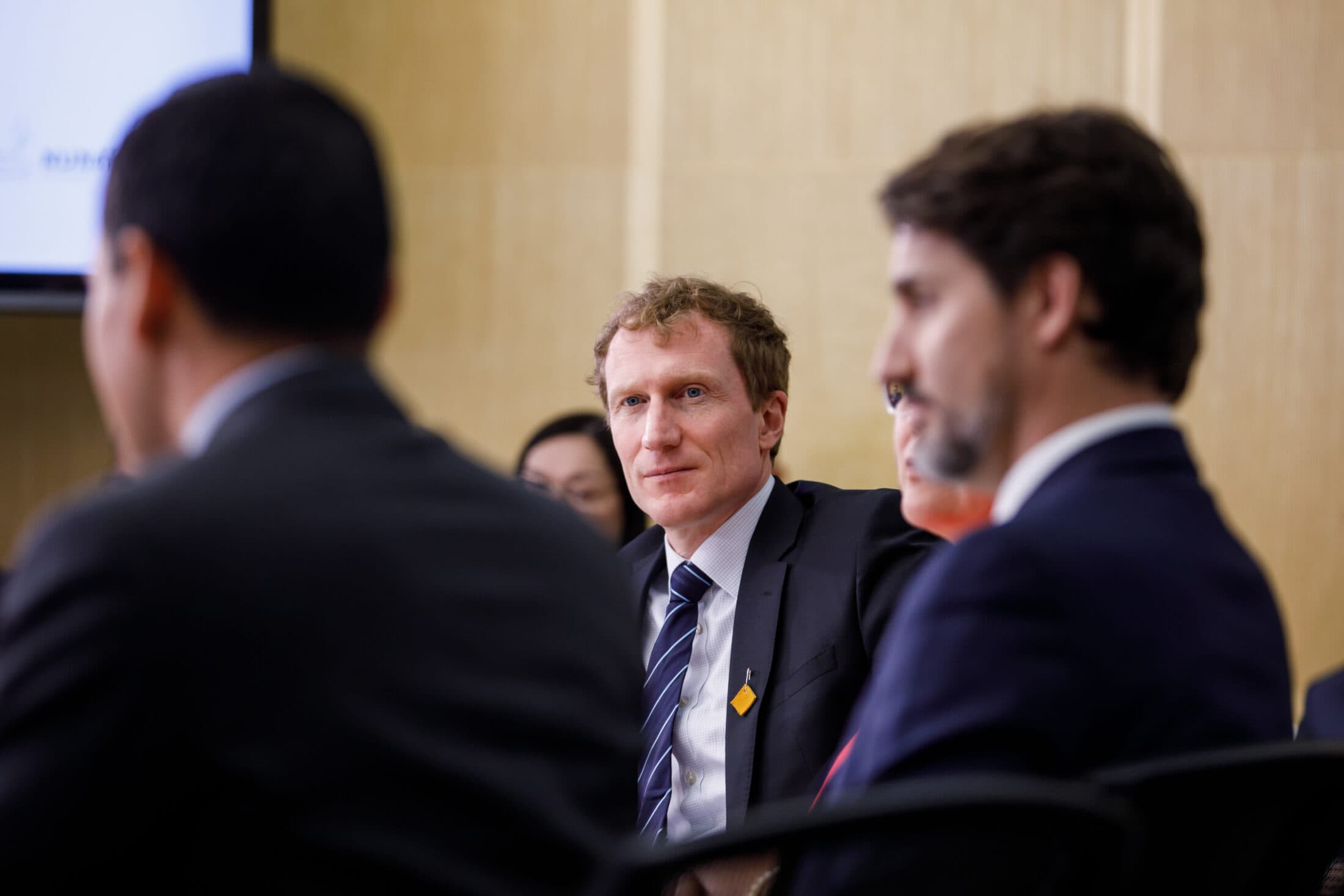 Marc Miller and Justin Trudeau seated indoors