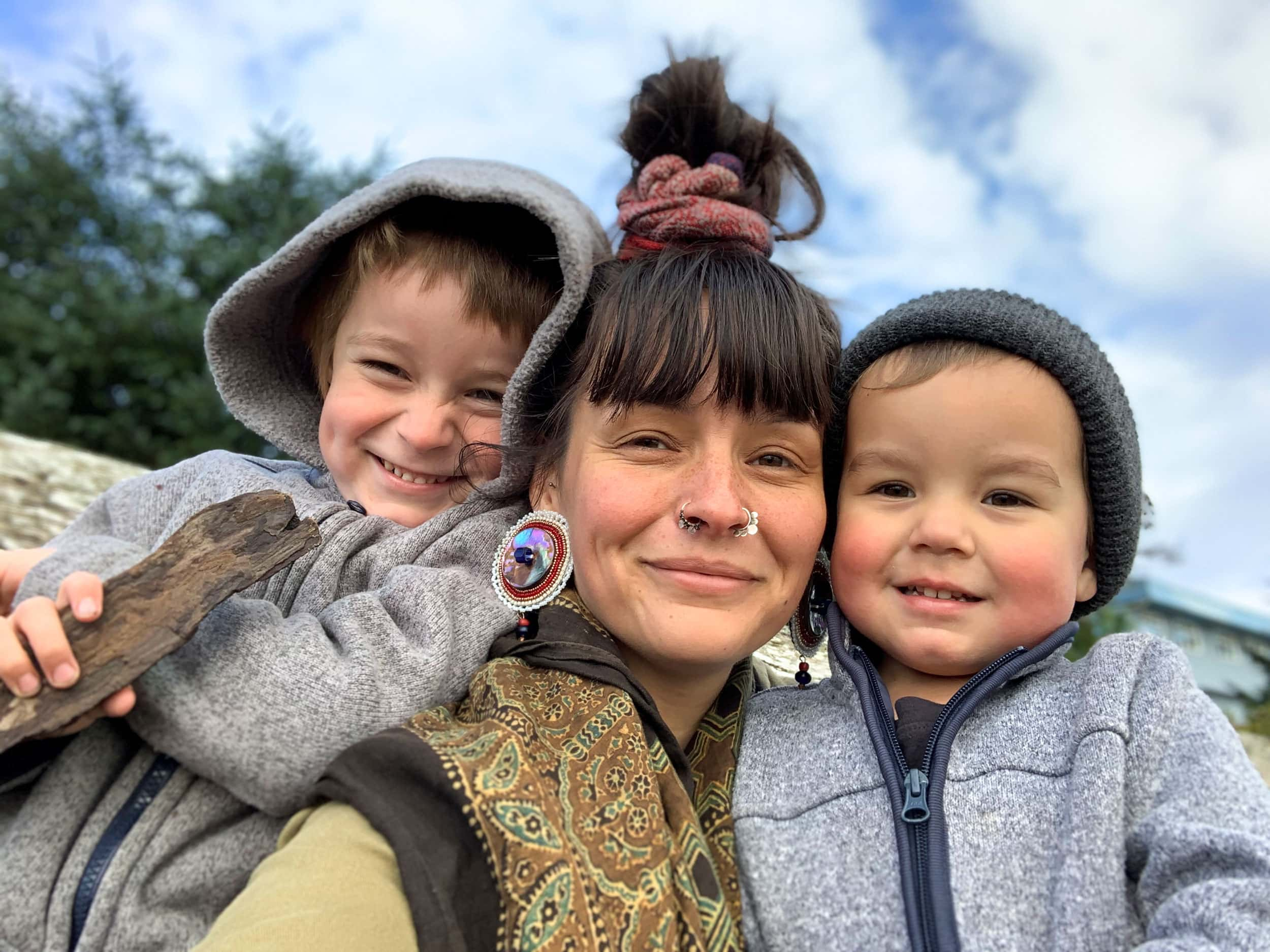 'Cúagilákv (Jess Housty) with her sons, Noen and Magnus