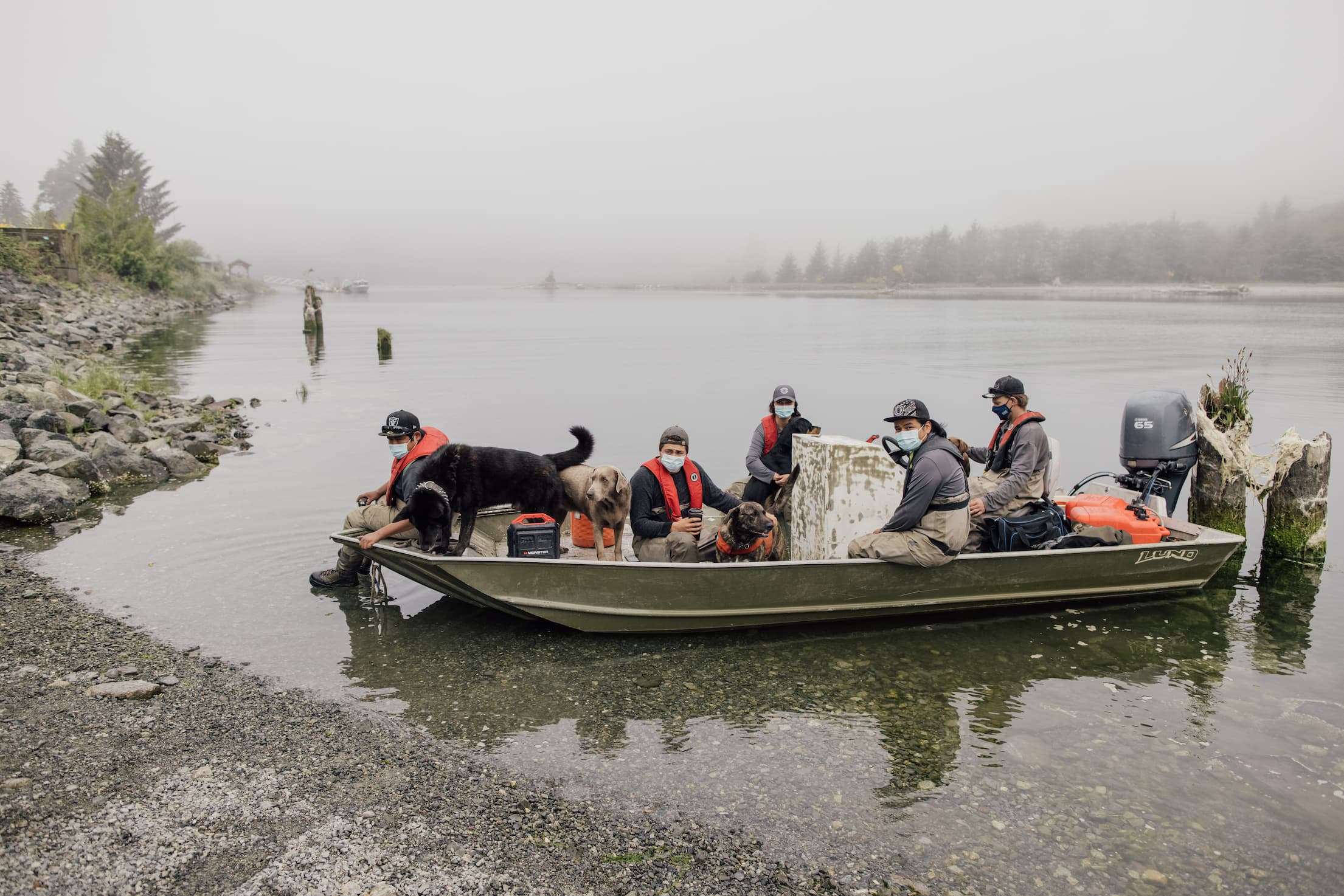 Group of Pacheedaht youth take a group boat ride to a salmon reclaimation project