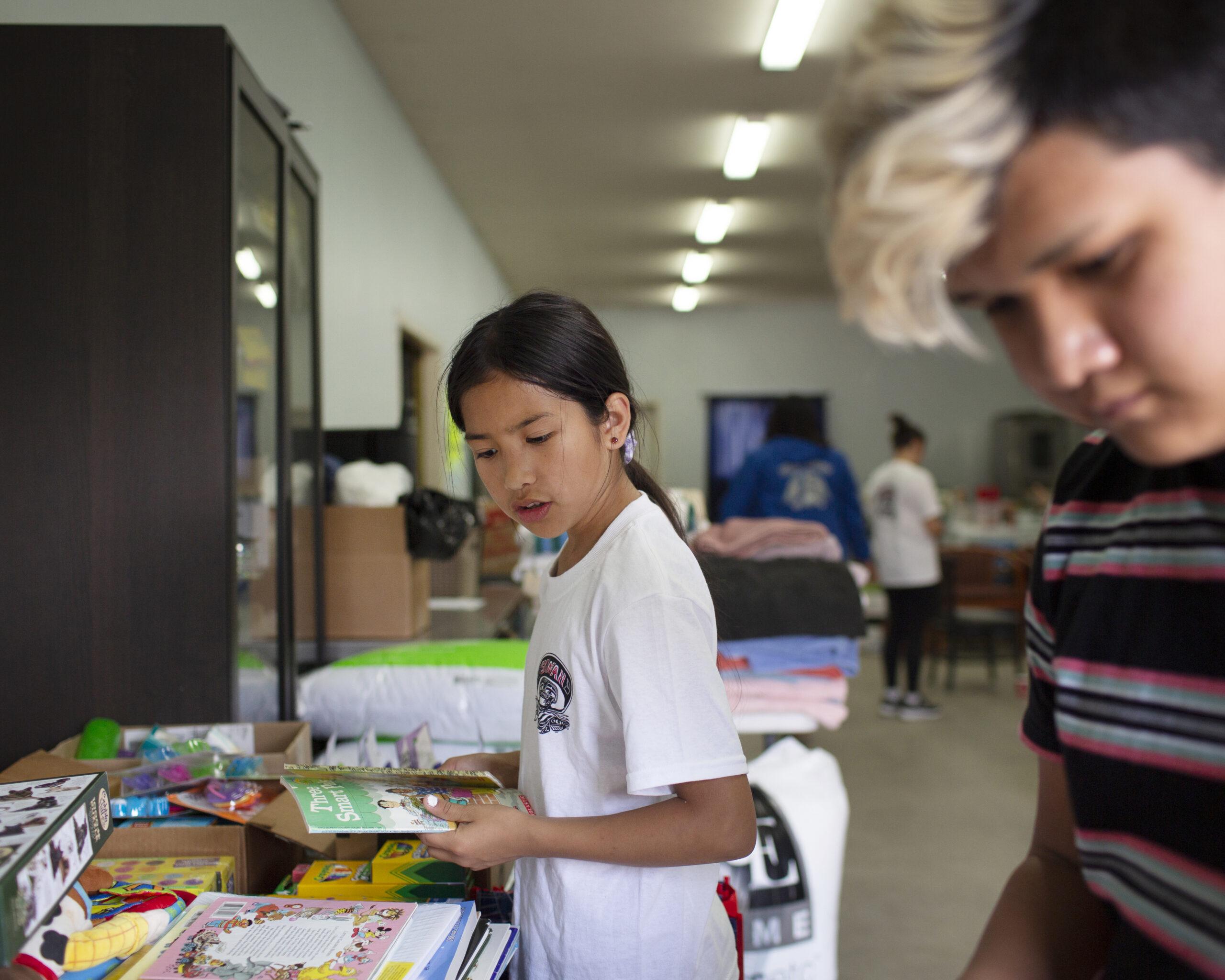 Children help organize donations