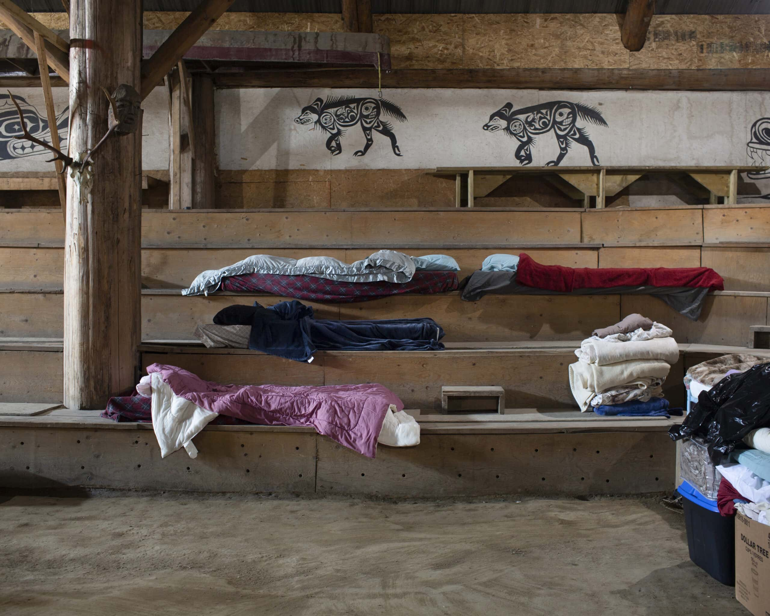 sleeping bags and towels in long house