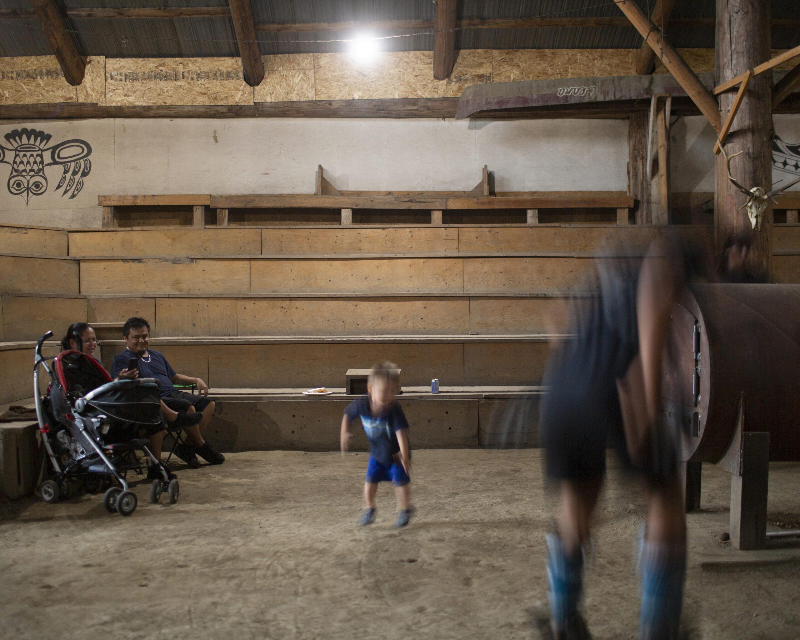 children dancing in long house