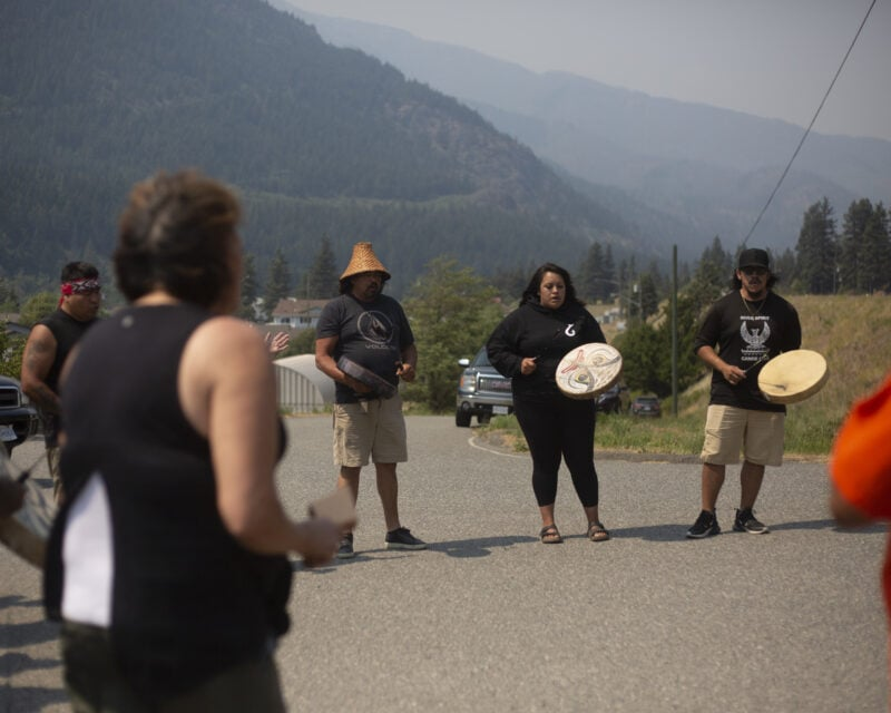 The Pil'alt Canoe Family, or River Spirit Canoe Family, sing and drum in a circle with members of the Nlaka'pamux First Nation