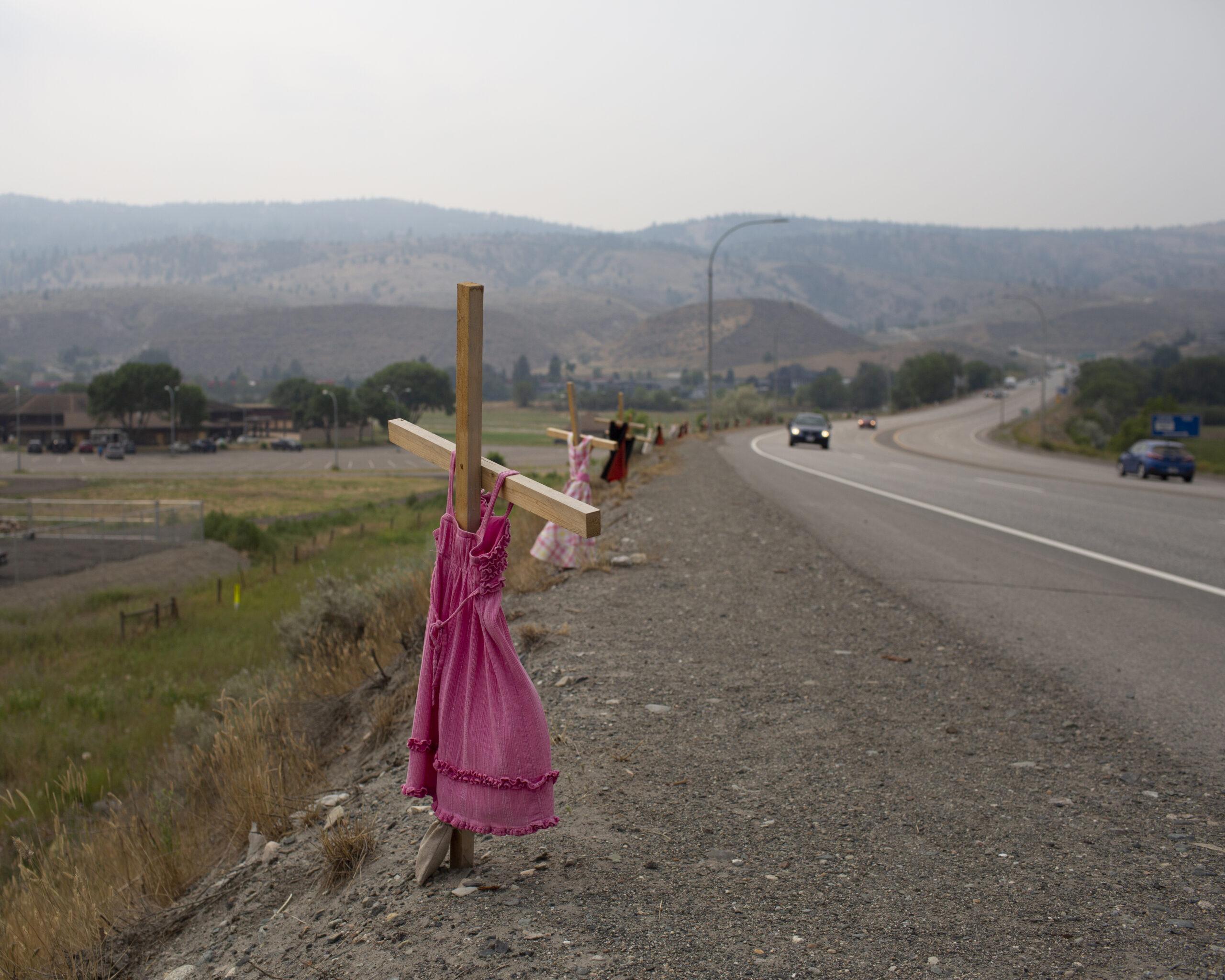 dresses hung on crosses along a road