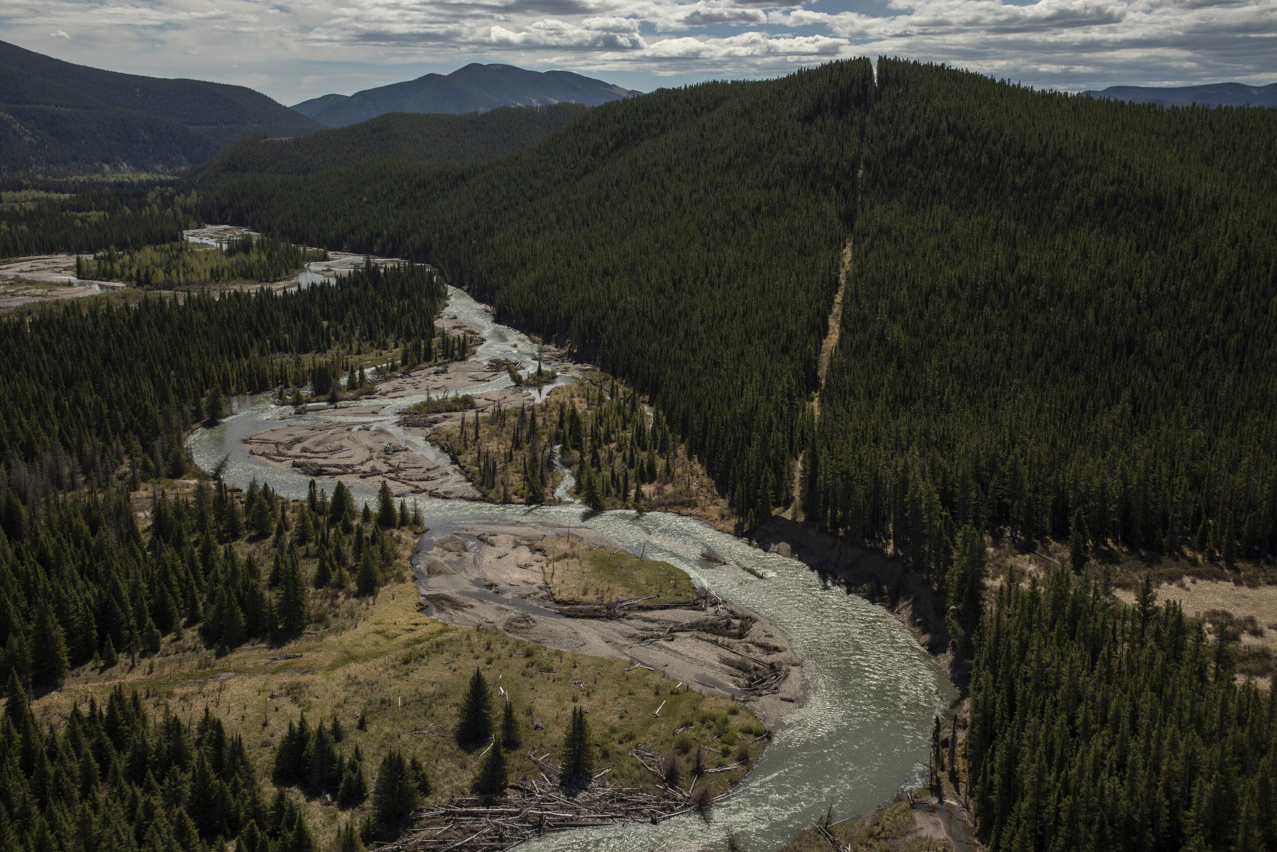 cutline running along mountain beside river