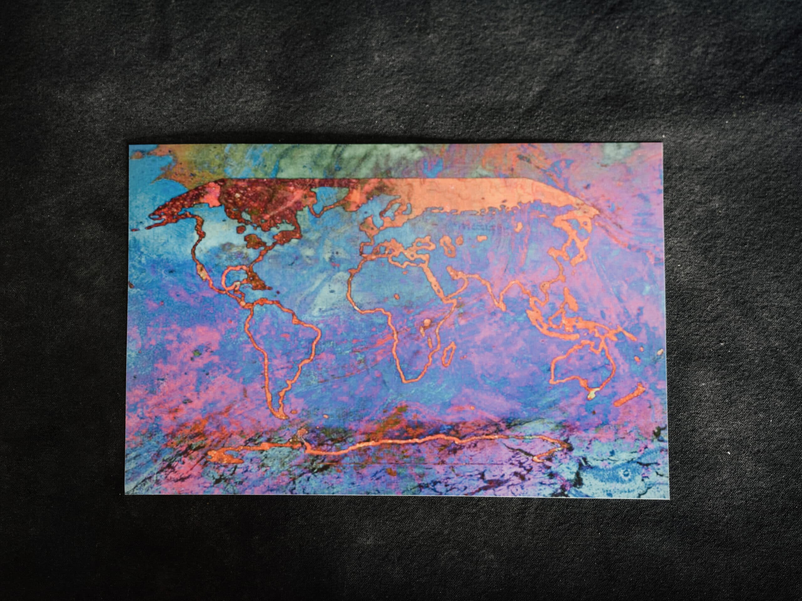 a coloured map of the world on a black background
