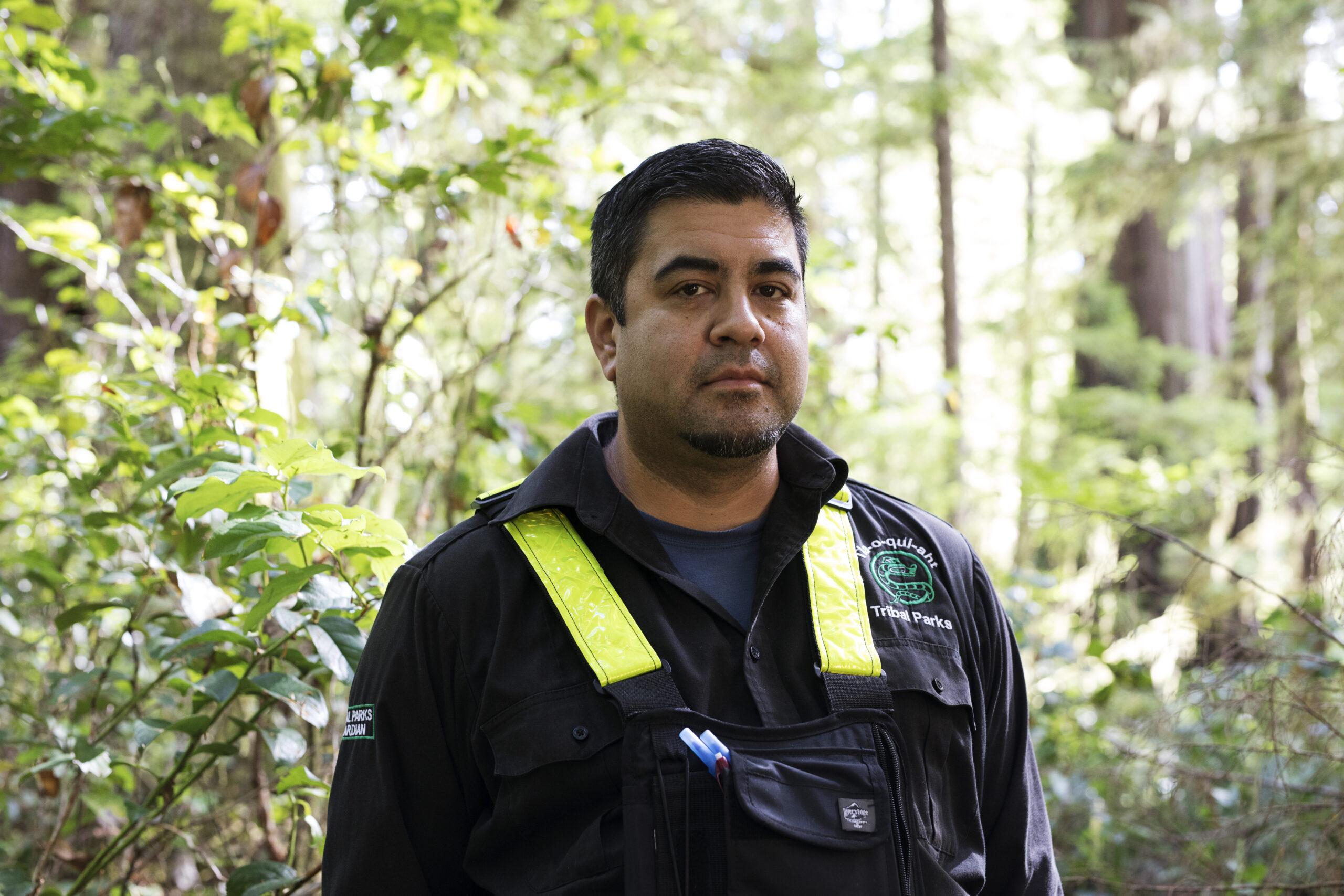 Joe Louie-Elley poses for a portrait along the Big Tree Trail