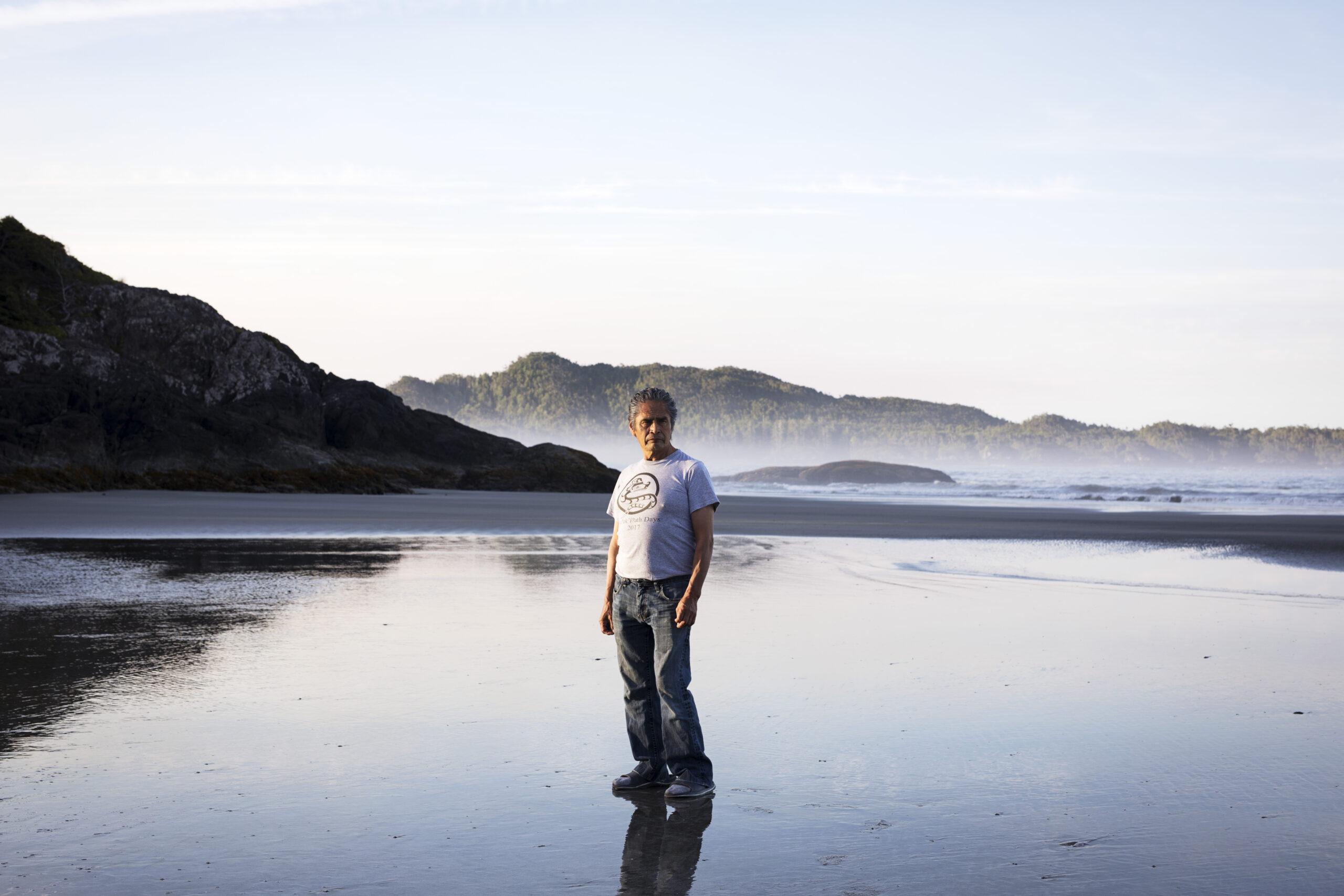 Joe Martin poses for a portrait on Chesterman Beach