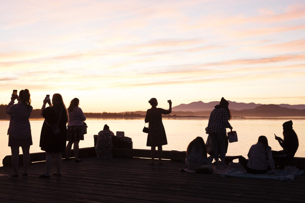 Tourists flock the Tofino's First Street dock at sunset