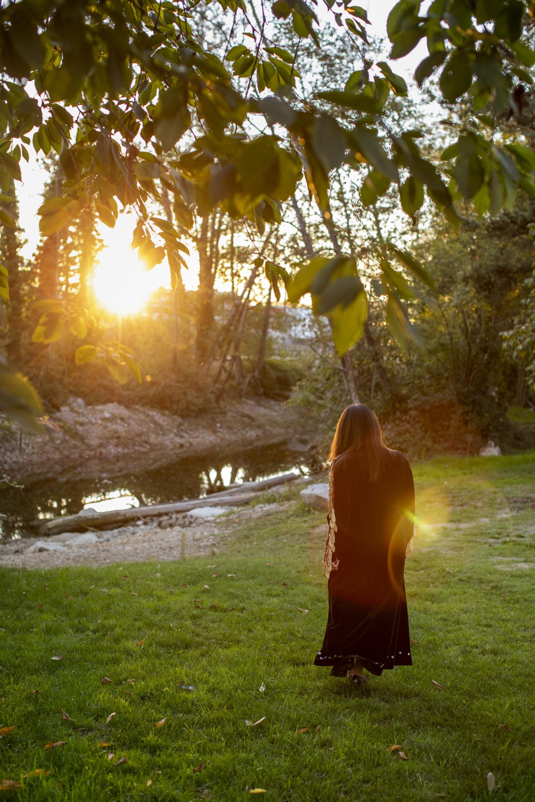 Shellene Paull walks towards a creek