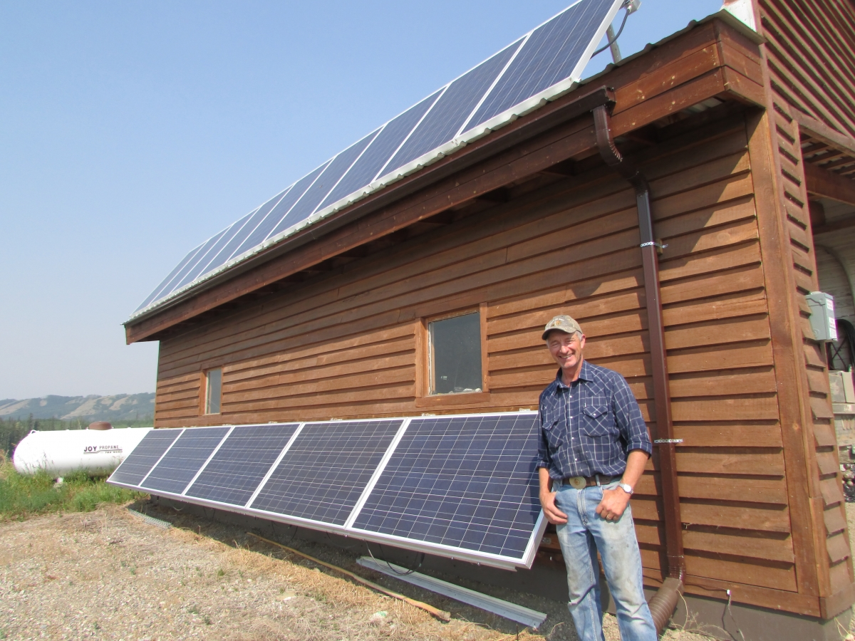 Ken Boon stands beside his solar panels, which feed electricity onto the B.C. power grid.